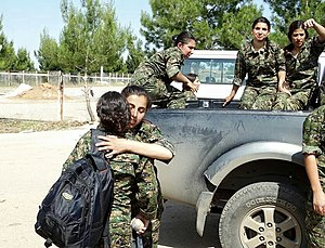 People's Protection Units - YPJ fighters embrace after battle, August 2015