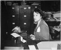 """Miss Clara Camille Carroll..., contributes her bit to the war effort in her daily work. She is one of the thousands of - NARA - 535813.tif"