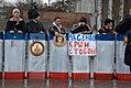 Отряд самообороны Крыма с щитами раскрашенными в цвета флага республики Крым охраняют памятник Ленина.jpg