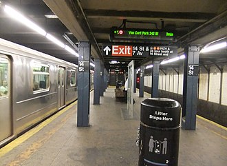 14th Street/Sixth Avenue (New York City Subway) - Uptown platform for local 1 (right) and express 2 and 3 trains (left)