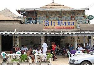 https://upload.wikimedia.org/wikipedia/commons/thumb/a/a4/1913380-Ali_Baba-The_Gambia.jpg/300px-1913380-Ali_Baba-The_Gambia.jpg
