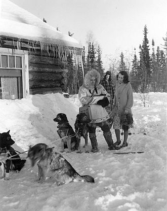 United States Census - This 1940 Census publicity photo shows a census worker in Fairbanks, Alaska.  The dog musher remains out of earshot to maintain confidentiality.