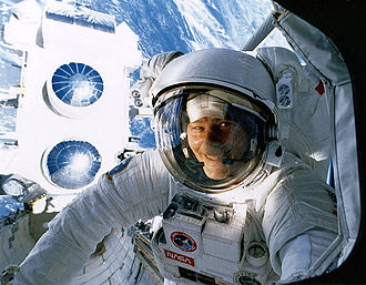 STS-37 - Ross during the first EVA; CGRO in the background