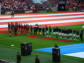 2012 Football League Cup Final - The Liverpool and Cardiff players lining up before the start of the match.