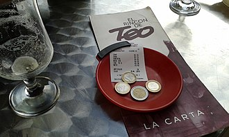 Gratuity - Leaving some change on the restaurant table is one way of giving a gratuity to the restaurant staff.