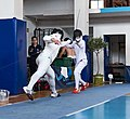 2nd Leonidas Pirgos Fencing Tournament. Lunge by the fencer Georgios Argiropoulos, 6th parry performed by his opponent.jpg