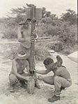 93 Squadron RAAF armourers with RP-3 rocket Labuan Aug 1945 AWM OG3164.jpg