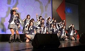 Smiling girls gesturing onstage