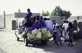 ASC Leiden - van Achterberg Collection - 1 - 233 - Un camion avec un corps ouvert plein d'hommes. Des jerry cans. Un village - Léré, Tombouctou, Mali - 9-29 novembre 1996.tif