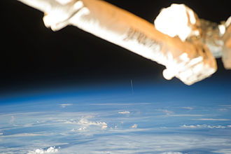 Johannes Kepler ATV - Johannes Keplers launch as seen from the ISS. The ATV is the thin white plume rising from the Earth in the center of the image.