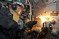 A Sailor conducts a boiler check aboard USS Carter Hall. (9247501397).jpg