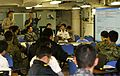 A U.S. Sailor with the Naval War College, second from left, goes over staff planning with Japanese service members during a planning exercise on the Japan Maritime Self-Defense Force helicopter destroyer JDS 130607-M-JU912-016.jpg