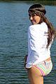 A bikini girl posing with smile at beach.jpg