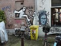 A mix of graffitiy and wall-paintings in the Palmstraat, Jordaan district in Amsterdam city from photographer, Fons Heijnsbroek.jpg