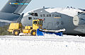 A snow plow with the U.S. Air Force 436th Civil Engineer Squadron clears snow in front of a C-17A Globemaster III aircraft at Dover Air Force Base, Del., Jan. 3, 2014 140103-F-BO262-051.jpg