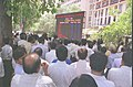 A strong crowd gathered in front of the giant electronic election results board put up by PIB outside Shastri Bhavan, in New Delhi on May 13, 2004.jpg