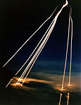 A time exposure of eight Peacekeeper (LGM-118A) intercontinental ballistic missile reentry vehicles passing through clouds while approaching an open-ocean impact zone during a flight test DF-SC-84-11662.jpg