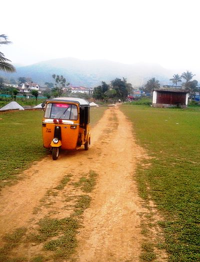 An Autorikshaw at the Mango Orange village, India. - Auto rickshaw