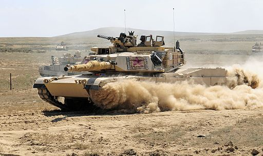 Abrams kicks up dust 140821-A-SF231-268