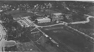 Benet Academy - Aerial view of the Benet campus, from the south, in 1984. Benet Academy was created from the merger of the St. Procopius Academy for boys and Sacred Heart Academy for girls in 1967.