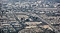 Aerial view of central Orange County overlooking South Coast Metro, John Wayne Airport, and the Irvine business district.JPG