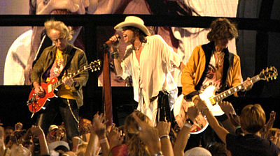 Brad Whitford, Steven Tyler, and Joe Perry of Aerosmith performing at the NFL Kickoff in Washington, DC on September 4, 2003