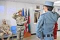 Afghan Brig. Gen. Abdul Raziq returns a salute to an Afghan police NCO graduate at Kandahar Regional Training Center.jpg