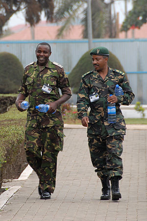 Tanzania People's Defence Force - A Tanzanian soldier (right) with his Kenyan counterpart