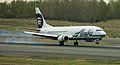 Alaska Air 737 Combi touching down (6259571810).jpg