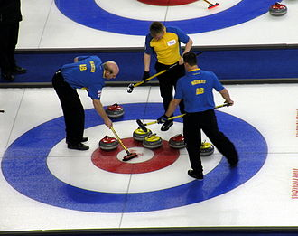 Kevin Martin (curler) - Martin sweeps a stone in the house at the 2009 Tim Hortons Brier