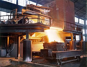 White-hot steel pouring out of an electric arc furnace.