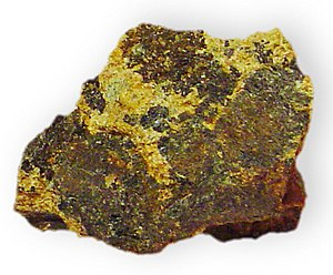 Cummingtonite - Image: Amphibole Cummingtonite w chlorite in schist Magnesium iron silicate 3800 foot level Homestake Mine Lawrence C Ounty South Dakota 2071