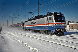 Silver, red, white, and blue locomotive in the snow