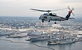 An MH-60R Sea Hawk helicopter flies over San Diego. (24546100368).jpg