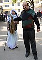 An elderly woman being carried at a polling booth to cast her vote for the Delhi Assembly Election, in New Delhi on February 07, 2015.jpg