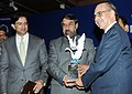 Anand Sharma presenting the JRD Tata Corporate Leadership Award 2010 to the Past President, AIMA, Dr. Ram Tarneja, at the AIMA's Foundation Day, in New Delhi on February 21, 2011.jpg