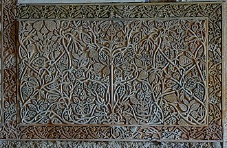 Arabesque - Islamic relief panel from Medina Azahara, Córdoba, Spain, c. 940. The central panel pattern springs from a central base and terminates within the space; most later ones do neither.