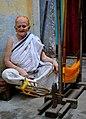 Assamese lady spinning threads.jpg