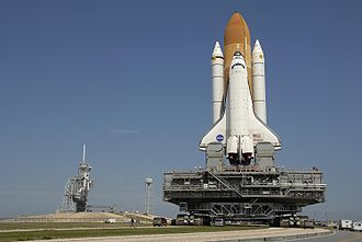 Atlantis on Crawler Transporter with Pad 39A in background.jpg