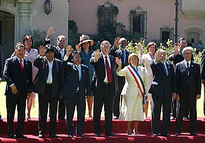 Bachelet saluting with world leaders at the inauguration ceremony in Valparaíso