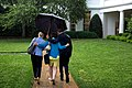 Barack Obama holding an umbrella for Valerie Jarrett and Anita Decker Breckenridge.jpg