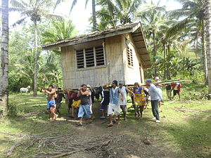 Communal work - Members of the community volunteering to move a house to new location. Though no longer commonplace, this method of moving houses has become a traditional symbol for the concept of bayanihan.