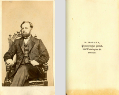 Bearded man seated by S Masury of Boston.png