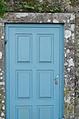 Blue door in a stone wall (8217064275).jpg