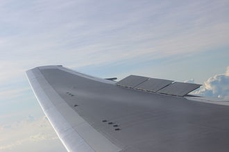 Spoiler (aeronautics) - A view of the right wing of a Boeing 767-300ER during descent with spoilers partially deployed.