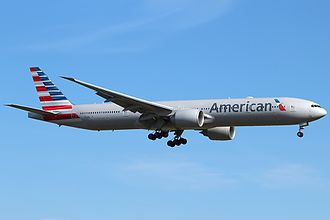 American Airlines - American Airlines Boeing 777-300ER in the new livery landing at London Heathrow Airport in 2013.