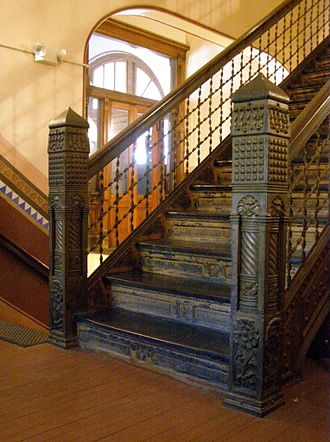 Carnegie Free Library of Braddock - Neo-medieval cast iron newel posts flank the staircase of the original 1889 section of the building.