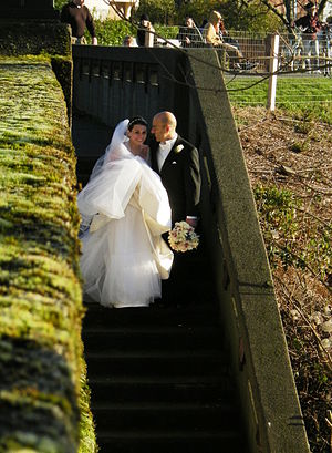 A bride and groom on a staircase of the West Q...