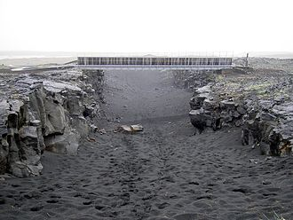 Divergent boundary - Bridge across the Álfagjá rift valley in southwest Iceland, that is part of the boundary between the Eurasian and North American continental tectonic plates.