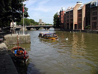 Public transport in Bristol - A ferry boat passes the Welsh Back landing stage, with Bristol Bridge in the background